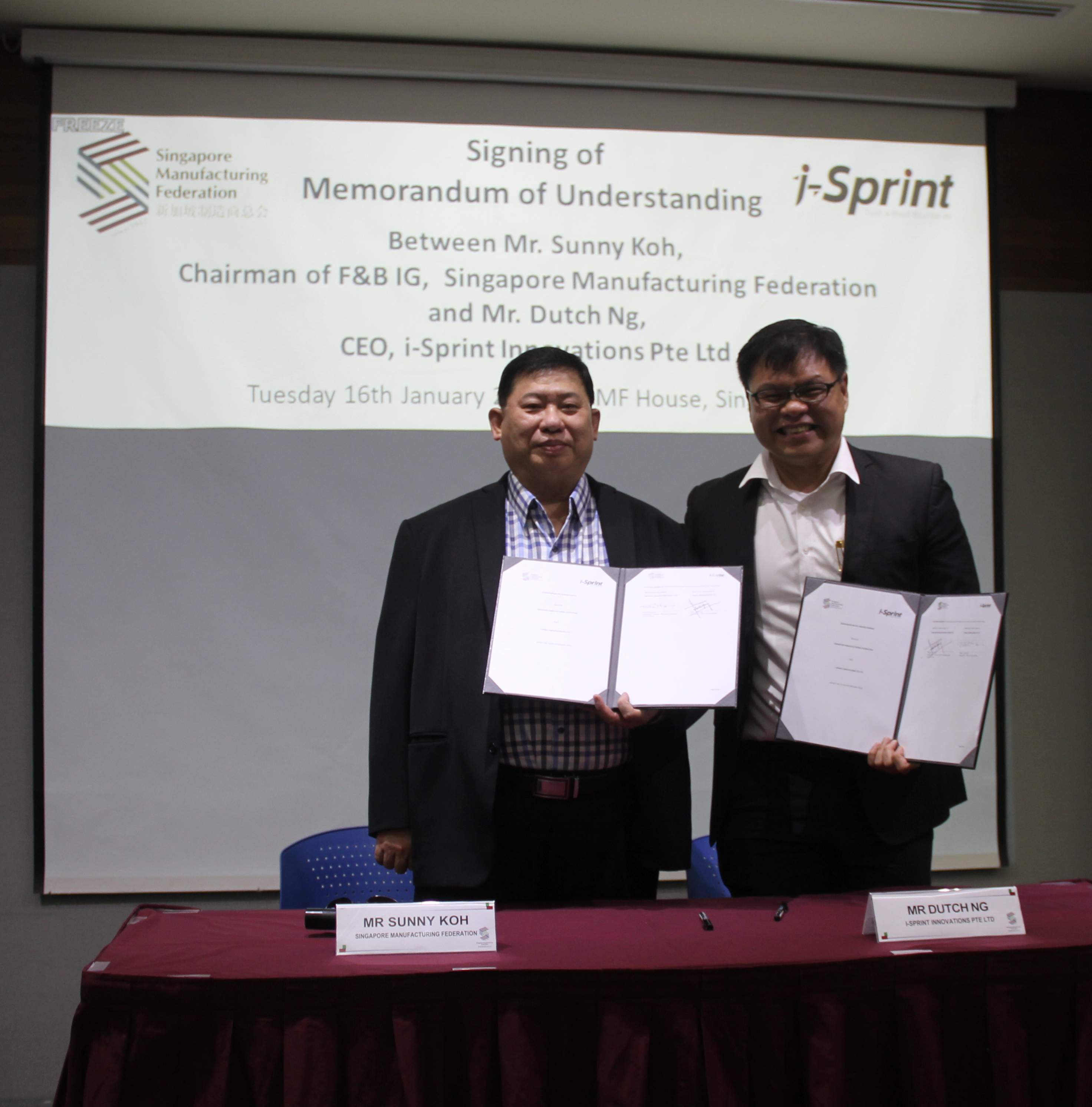 i-Sprint Innovations CEO: Mr Dutch Ng signing Memorandum of Understanding with SMF Chairman of F&B IG: Mr Sunny Koh